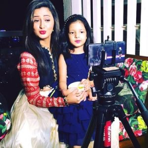 With Her Daughter Manya